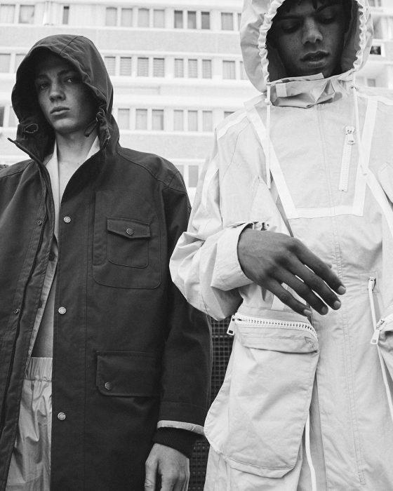 Quentin wears coat hoodie Timberland, pants & jacket Kenzo. Angy wears parka jacket & trousers Kenzo, shoes Sankuanz.