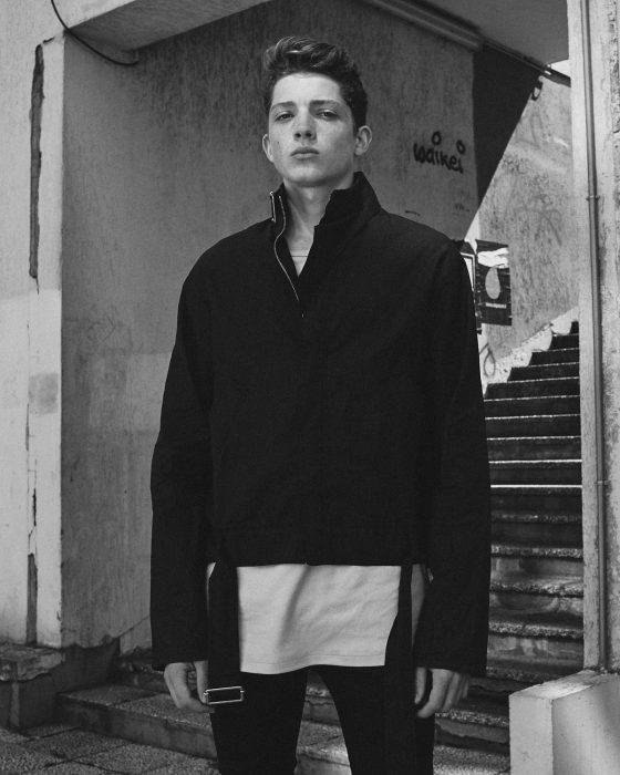 Quentin wears jacket Maison Margiela, t-shirt Hed Mayner, jeans Diesel Black Gold, shoes Acne Studios.