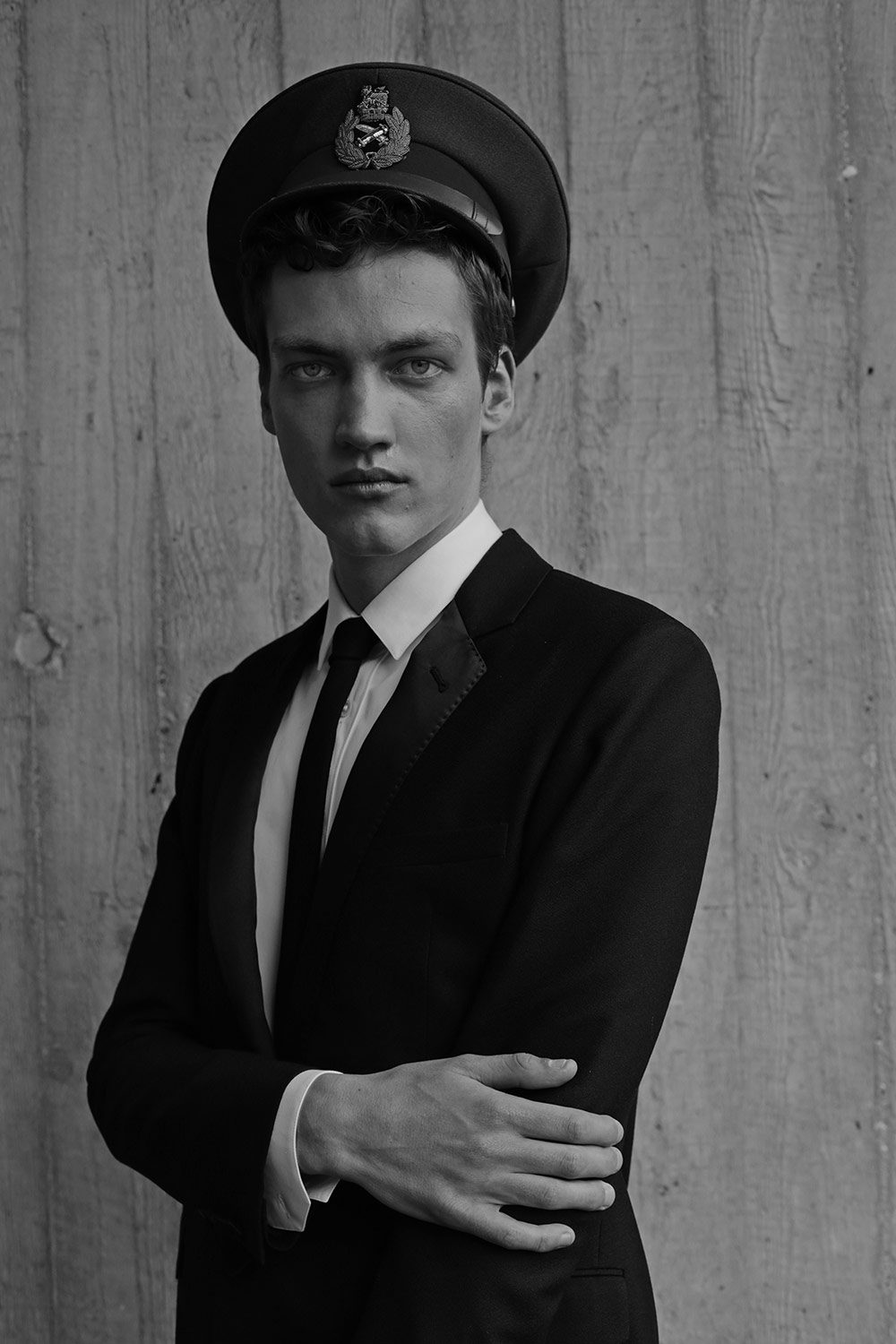Suit, shirt & tie Saint Laurent by Hedi Slimane, cap Surplus Doursoux.