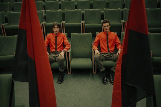 Suit, shirt & tie Louis Vuitton, cap Surplus Doursoux.