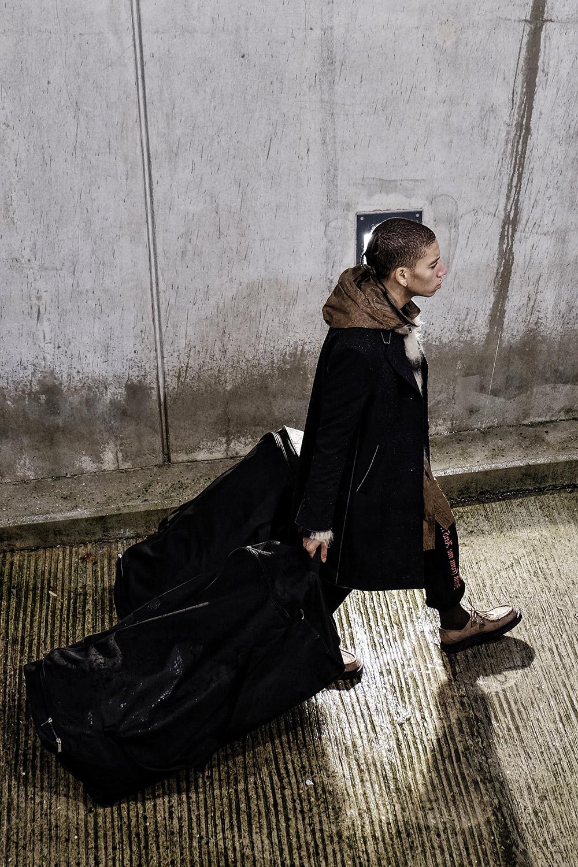Coat, jumper and shoes LOUIS VUITTON, raincoat DAMIR DOMA, trackpants VETEMENTS at MATCHES FASHION, socks FALKE