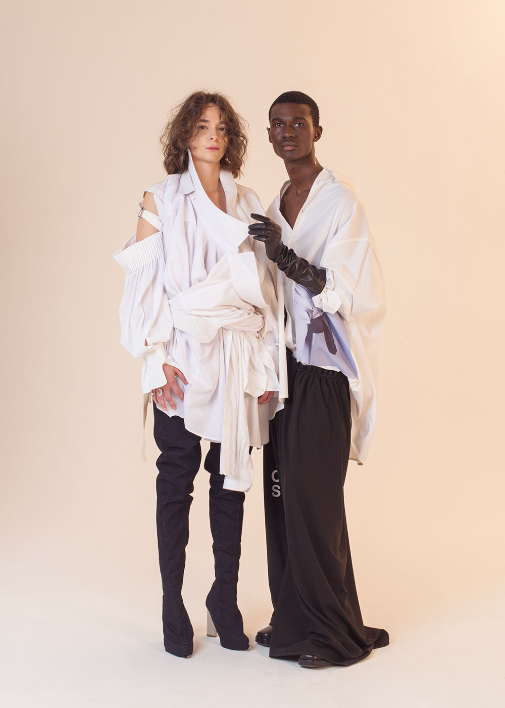 Gabrielle : Multi-White shirt Alexandre Paty, Ring Persta Jason Harderwijk: Shirt Raf Simons, Pants Hood by Air, Gloves Georges Morand