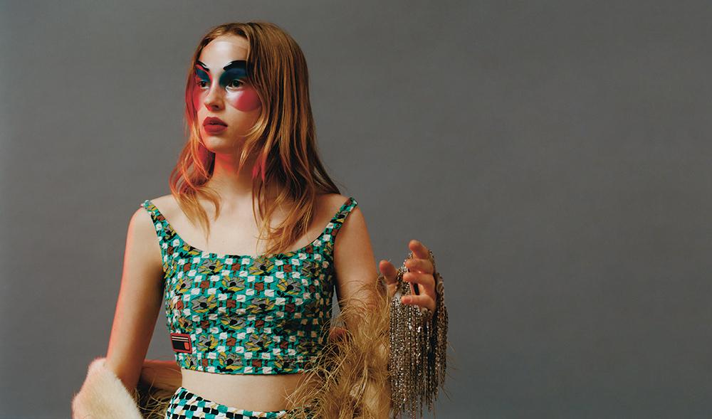 Bra, panties & feather-trimmed fur scarf by Prada, gloves by Wanda Nylon.