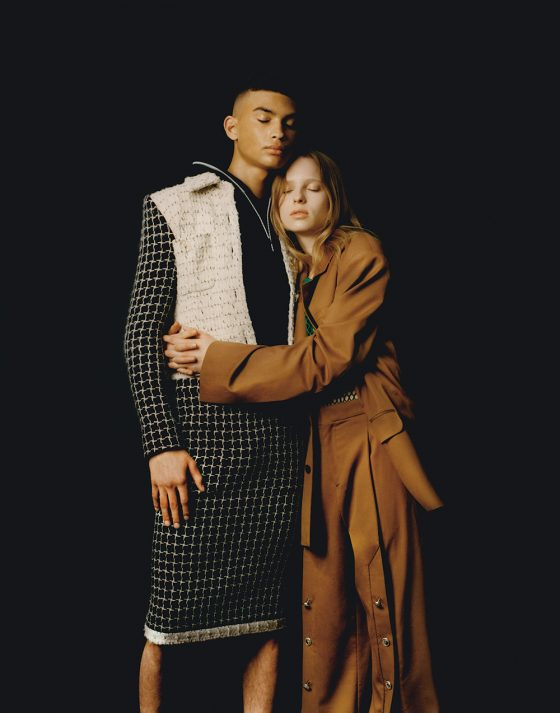 Dylan G. wears jacket & skirt by Chanel, cropped top by Fila. Fern wears suit by Y/Project, fishnet tank top by Sacai.
