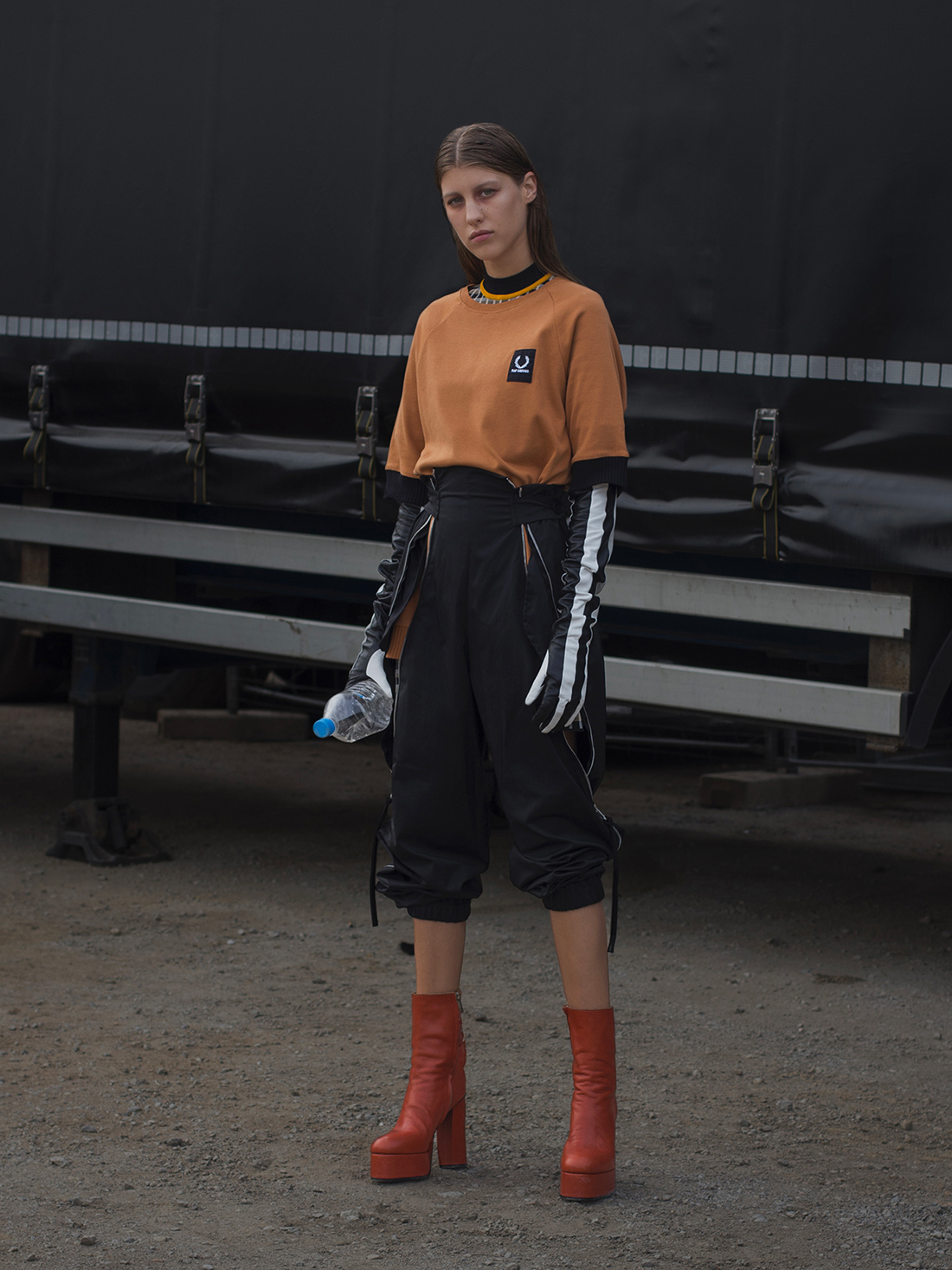 Rasa wears dress Pringle of Scotland, jumper Fred Perry, pants Sportmax, boots Christian Dada and Gloves Kenzo.
