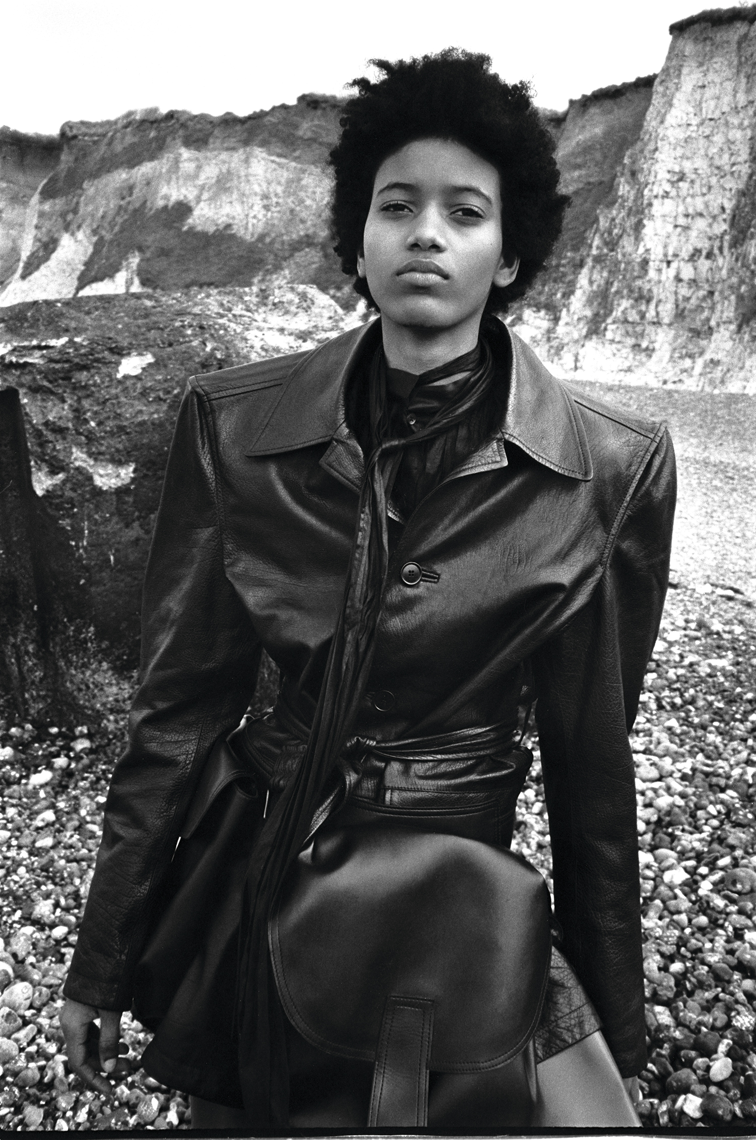 Coat & boots by Balenciaga, shirt by Dries Van Noten, belt with oversized pockets by Marni.