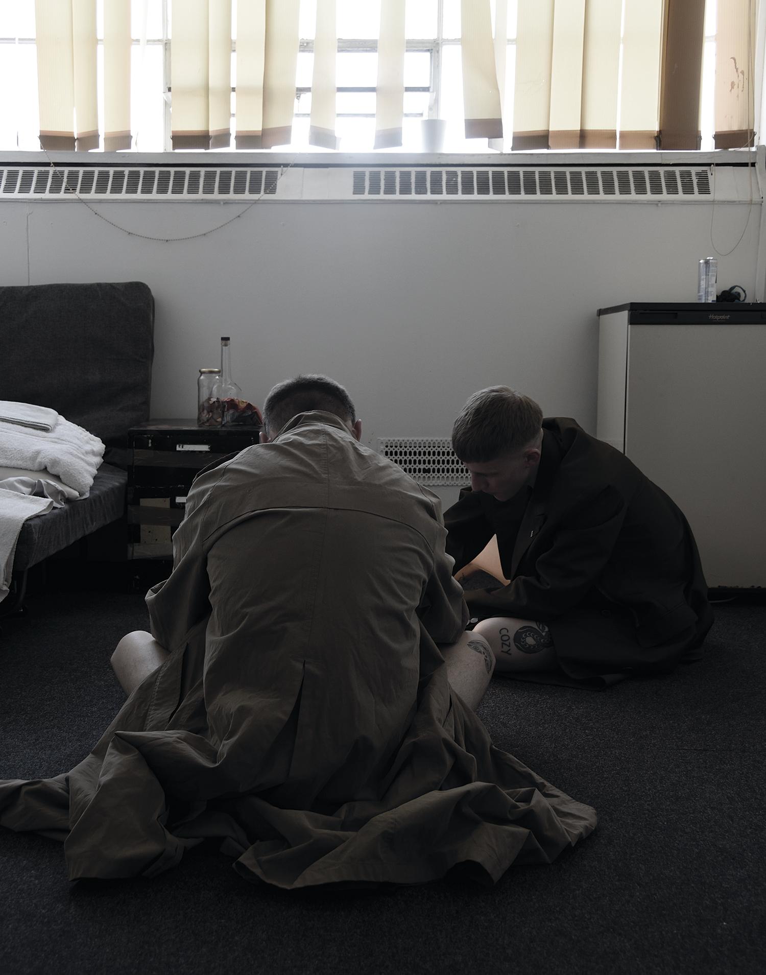 Josh wears trench coat by Lanvin, Tim wears trench coat from stylist's archive.