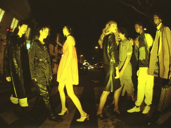 Seungchan wears all clothes by Raf Simons. Dohyun wears jumpsuit by Marine Serre, sweater & boots by Ann Demeulemeester, belt by Paco Rabanne.Shaodi wears dress by Patou, shoes by Givenchy. Rosalieke wears jacket & skirt by Prada, tights by Falke, shoes by Ami. Mustafa wears jumpsuit by Fendi, shirt & belt by Valentino, shoes by Louis Vuitton. Kelvin wears jacket (worn on the shoulder) by Dries Van Noten, sweatshirt by Fila, trousers by Boramy Viguier, keychains & shoes by Givenchy. Dennis wears jacket & turtleneck by Acne Studios, trousers by MSGM, briefcase by Louis Vuitton