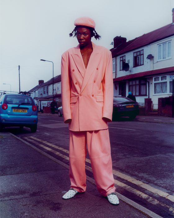 Brian wears jacket & trousers by Paul Smith, shoes by Lacoste, hat by Kangol, jewellery from stylist's archive