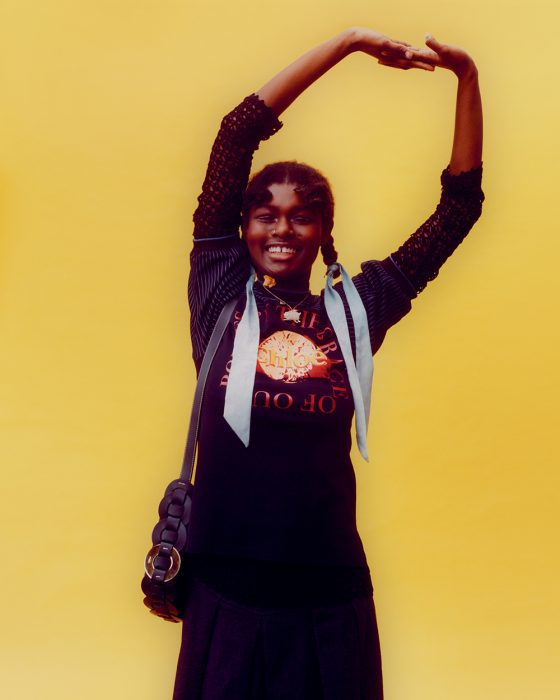 Coumba wears top & bag by Chloé, long sleeve top & jewellery from stylist's archive